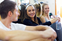 Young people resting after class in the gym. Royalty Free Stock Photography