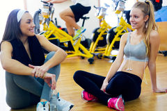 Young people resting after class in the gym. Royalty Free Stock Images