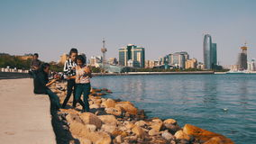 Young People Resting on the Embankment of Baku near the Caspian Sea, Azerbaijan. stock video