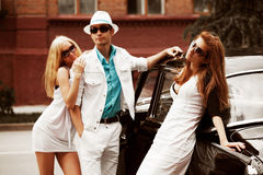 Young people with a retro car Royalty Free Stock Images