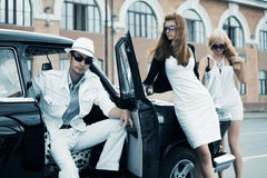 Young fashion people by retro car Stock Image