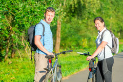 Young people riding bikes Royalty Free Stock Image