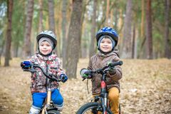 Young people riding bikes stock photo