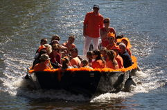 Young people riding in a boat Stock Photo