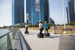 Young people riding on an electric scooter, Singapore Stock Photo