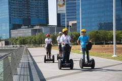 Young people riding on an electric scooter, Singapore Royalty Free Stock Photos