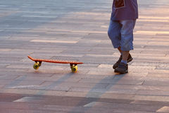 Young people riding on a skateboard Stock Images