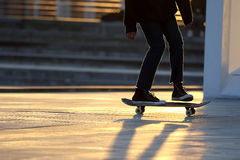 Young people riding on a skateboard. The young people riding on a skateboard Stock Photography