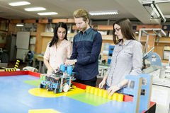 Young people in the robotics classroom Stock Image