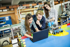Young people in the robotics classroom. Young people working in the robotics classroom Royalty Free Stock Images