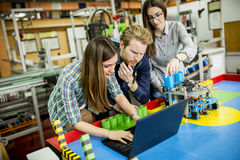 Young people in robotics classroom. Young people working in the robotics classroom stock image