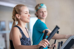 Young people on run simulators in gym Royalty Free Stock Photos