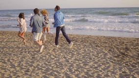 Young People Running On The Beach stock footage