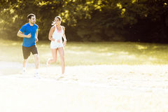 Young people running in nature Stock Photos