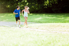 Young people running in nature Stock Photo