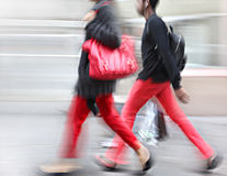 Young people at rush hour walking in the street. Intentional  motion blur Royalty Free Stock Photo