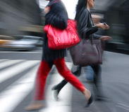 Young people at rush hour walking in the street. Stock Images