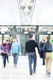 Young People Rushing through Corridor, Motion Blur Royalty Free Stock Photos