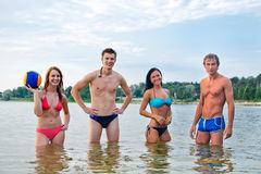 Young people in the sea Stock Images