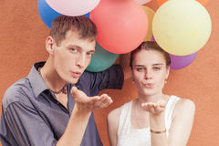 Young people sending a blow kiss to the camera Stock Photography