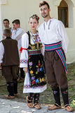 Young people from Serbia in traditional costumes. ROMANIA, TIMISOARA - JULY 12, 2015: Unidentified youths from Serbia, in traditional specific costumes, attended royalty free stock photography