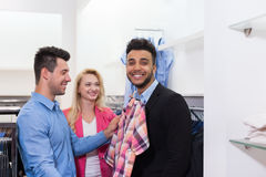 Young People Shopping, Happy Smiling Friends Customers In Fashion Shop Fitting Shirt. Young People Shopping, Happy Smiling Friends Two Couple Customers In Stock Photos