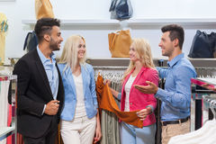 Young People Shopping, Happy Smiling Friends Two Couple Customers In Fashion Shop Stock Photos