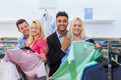 Young People Shopping, Happy Smiling Friends Two Couple Customers In Fashion Shop. Choosing Clothes Shirts Stock Photography