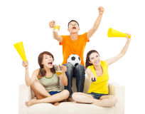 Young people shouting to encourage their  team  win. At home Stock Photography