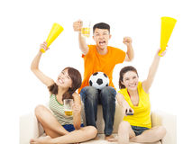Young people shouting to encourage their  team  win. Over white background Stock Photos