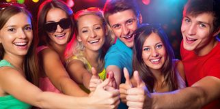 Young people show thumb up royalty free stock image