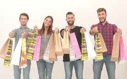 Young people showing their colorful shopping bags. Photo with copy space royalty free stock image