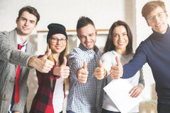 Young people showing thumbs up Stock Images