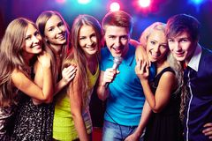 Young people singing at party Stock Photos