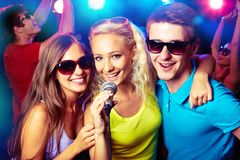 Young people singing at party Royalty Free Stock Image