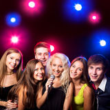 Young people singing at party Royalty Free Stock Images