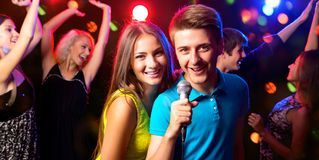 Young people singing at party stock image