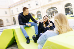 Young people sitting on the lounge seats in Vienna Stock Photography