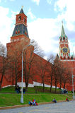 Young people sitting by the Moscow Kremlin wall Stock Images
