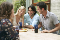Young People Sitting At Verandah Table Royalty Free Stock Photo