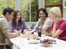 Young People Sitting At Verandah Table Stock Photos