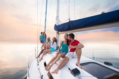 Young people sitting on yacht Stock Photo
