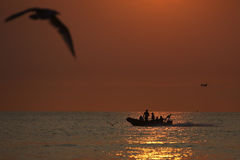 Small boat at sunset Royalty Free Stock Images