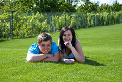 Young people smiling. And lying on the grass Stock Photo
