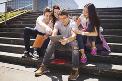 Young people and social media. Outdoors Royalty Free Stock Images