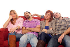 Young People on Sofa Stock Image