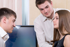 Young people solve a problem about the monitor Stock Photos