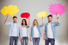 Young people with speech bubbles Stock Photo