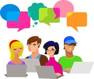 Young people with speech bubbles and computers Royalty Free Stock Photo