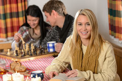 Young people spend winter holiday country cottage Stock Photography